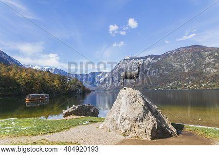 Triglav National Park, Slovenia, October, 2020: Mountain Goat Statue By Lake Bohinj In Slovenia