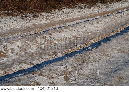 Frozen Dirt Road Leading To A Construction Site, Snow