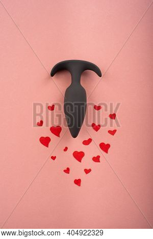 Butt Plug And Hearts On A Pink Background. Love Symbol For February 14