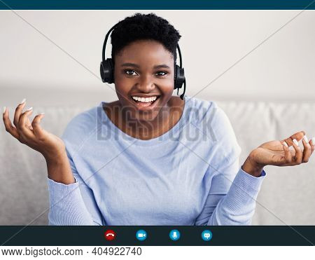 Remote Work And Technology. Black Woman Wearing Headset Having Video Conference, Talking To Camera D