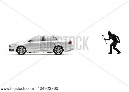 Car burglar with a crowbar walking towards a silver car isolated on white background
