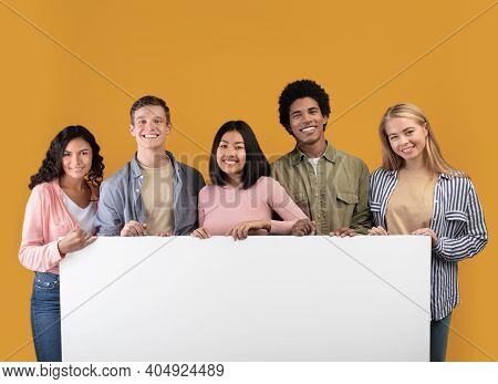 Education, Ad And Student Recommendations. Diverse Teens Cheerful International Students Holding Big