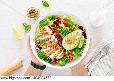 Grilled Chicken Meat And Fresh Vegetable Salad Of Tomato, Avocado, Lettuce And Spinach. Healthy And