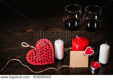 Blank, Craft Paper, Candle, Red Heart, Rope, Wine On Brown Wooden Background With Space. Place For T