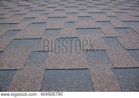 Copper Brown Roofing Asphalt Shingles Texture Background. A Close-up Of An Asphalt Laminated, Dimens