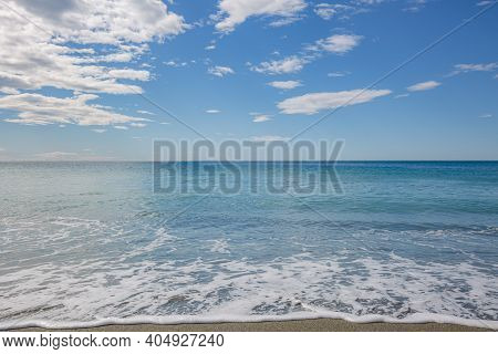 Blue Sea Water Waves With White Foam And Bubbles Washes The Beach. Winter See. Riva Trigoso On Ligur