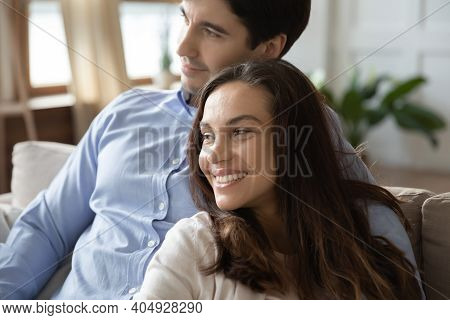Close Up Dreamy Smiling Couple Hugging, Visualizing Good Future