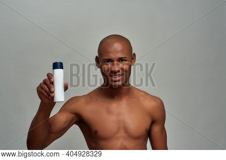 Male Introducing A White Can With Spray While Lifting It In His Right Arm