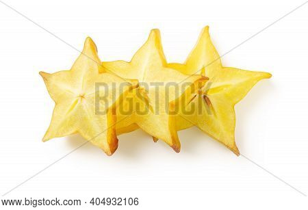 Three Slices Of Juicy Carambola Or Star Fruit Isolated On White Background. Ingredient For Cocktails