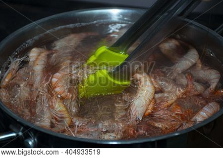Cooking  Fresh  Caught Prawns And  Strips  In  Pot  Of Water  In Pan