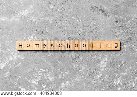 Homeschooling Word Written On Wood Block. Homeschooling Text On Cement Table For Your Desing, Top Vi