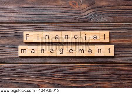 Financial Management Word Written On Wood Block. Financial Management Text On Cement Table For Your