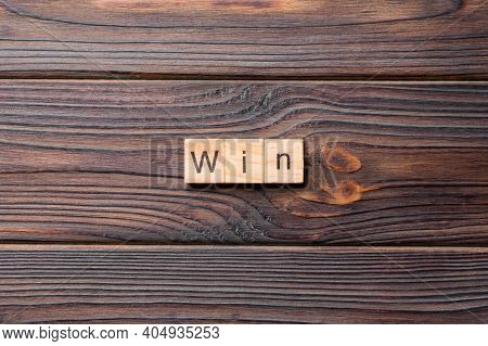 Win Word Written On Wood Block. Win Text On Cement Table For Your Desing, Concept