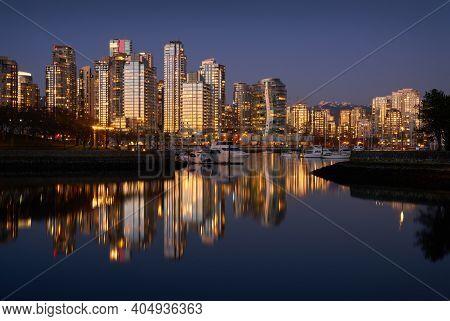 Sunset Reflection False Creek Vancouver. Yaletown Towers Across False Creek At Sunset In Vancouver.