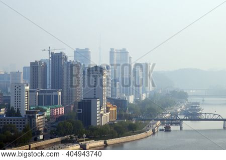 Skyline And Taedong River In The Morning Fog. View From The Yanggakdo Island