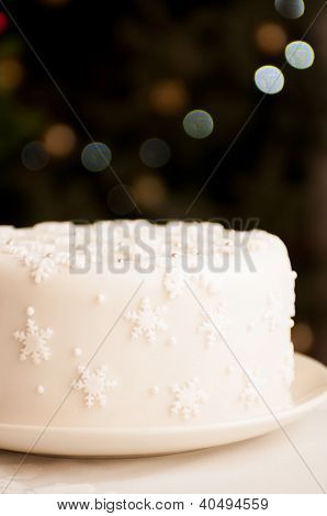 White Christmas Cake Covered In Snowflakes