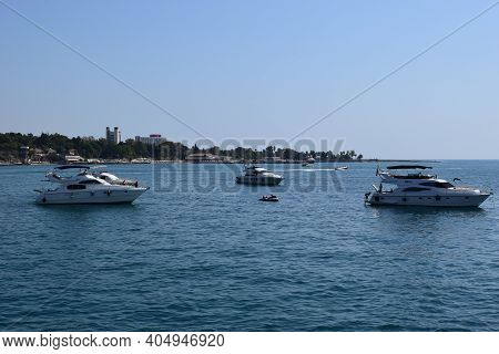 Jetski And Yachts On The Sea. Clear Sea Blue Sky. Motor Transport In The Sea, Scutter And Boats. Ant