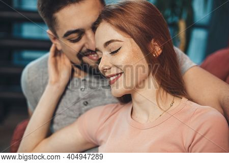 Adorable Ginger Woman With Freckles Is Embracing Her Lover While Dating On Valentines Day