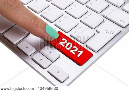 Close Up View Of A Finger Pushing On A Red 2021 Button Of Computer Keyboard. Computer Notebook Keybo