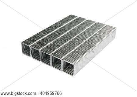 Metal Staples Isolated On White Background. Set Of Stapler Staples Clips On White Isolated Backgroun
