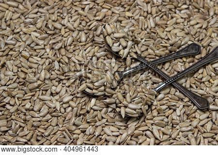 Peeled Seeds In Full Screen. Sunflower Seeds. Seeds Without Husks. A Spoon Full Of Seeds