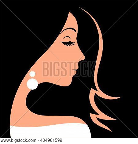 Beautiful Face Of A Girl With Closed Eyes On A Black Background.