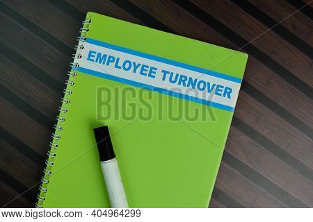 The Book Of Employee Turnover Isolated On Wooden Table.