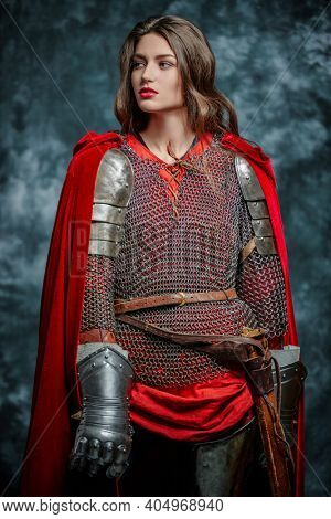 Portrait of a beautiful female knight in armor of noble birth. History of the Middle Ages.