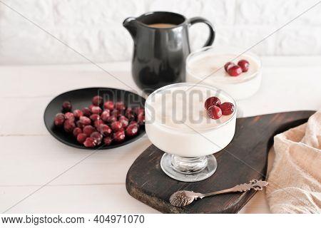 Traditional Italian Panna Cotta Dessert. Homemade Panna Cotta With Garden Grown Cranberries. Frozen