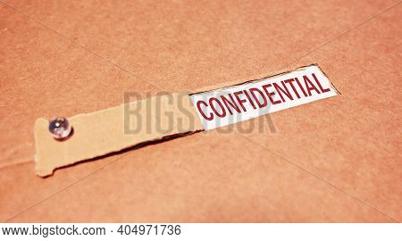 The Word Confidential Under Torn Paper. Business Concept