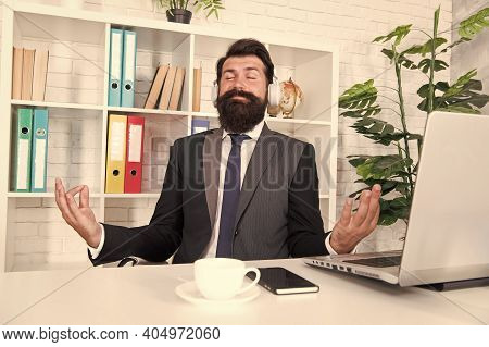 Keep Calm And Meditate. Bearded Man Meditate At Workplace. Manager Sit In Meditation Pose. Concentra