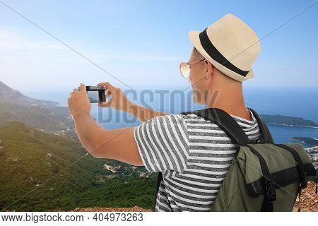 Traveler Taking Photo Of Mountains And Sea During Summer Vacation Trip