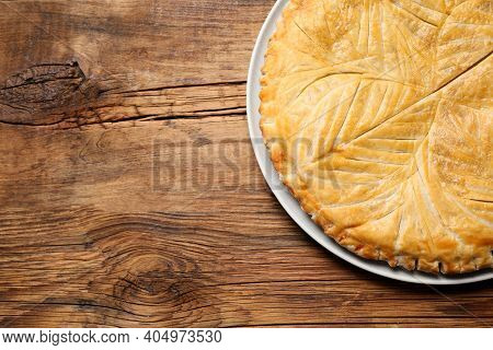 Traditional Galette Des Rois On Wooden Table, Top View. Space For Text