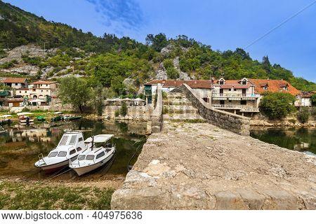 Old Bridge in Rijeka Crnojevica River near Skadar Lake - Montenegro - travel background
