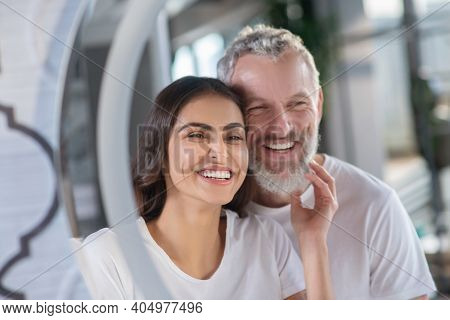 Smiling Man And Woman Looking At The Mirror