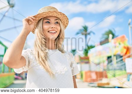 Young caucasian tourist girl smiling happy walking at fairground.