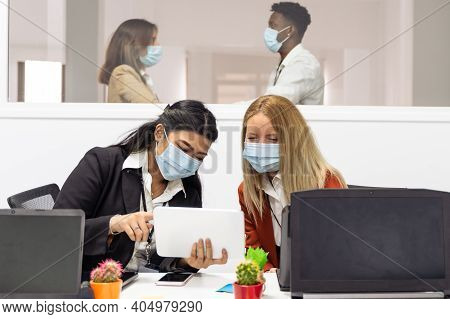 Multiracial Creative People In Office. Four People In Office With Protective Masks Without Distance