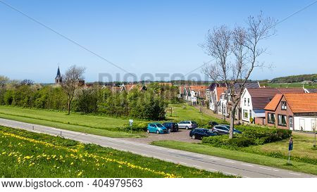 Panorama Village Oudeschild With Martinus Church And Trraditional Gable Houses On The Wadden Island