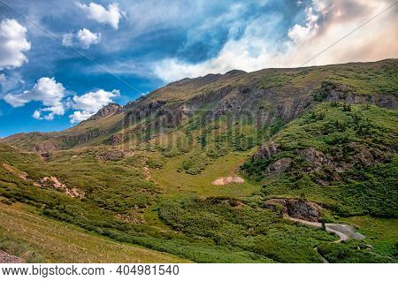 Photograph Of The Beautiful Lush Landscape Of Stony Pass In Colorado Beneath Summer Skies With The S
