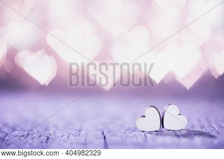 Two handmade wooden hearts on beautiful bokeh background. Vintage style. Love Valentine's Day concept.