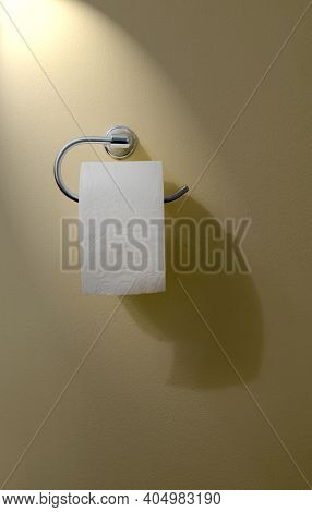 Vertical Shot Of A Roll Of Toilet Paper Hanging On A Toilet Paper Holder Attached To A Wall.