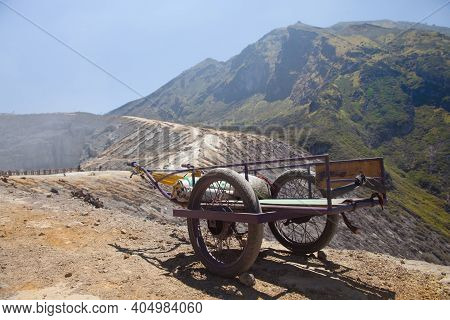 Old Cart On A Mountain Waiting For Carrying Sulfur Down From A Mountain. Ijen Volcano On Java Island