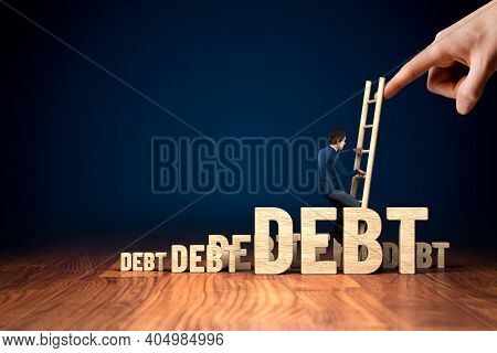 Businessman Successfully Break Out Of Debt. Company Bankruptcy And Crisis Management Concept. Helpin