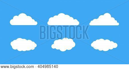 Collection Of Clouds . Vector Icon On Blue Background. Sky Illustraton. Cloud Icons. Weather Concept