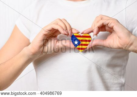 Catalan Patriotism And Independence Concept. Love Catalonia. The Girl Holds A Heart In The Form Of T