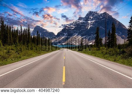 Scenic Road In The Canadian Rockies. Dramatic Colorful Sunset Sky Art Render. Taken In Icefields Par