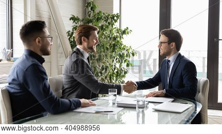 Happy Business Partners Shaking Hands, Making Deal After Negotiations