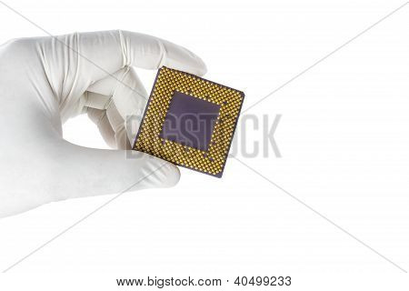Hand holding a CPU