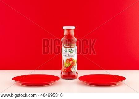 Prague,czech Republic -  17 January, 2021: La Torrente Basil Tomato Sauce And Two Red Plates. La Tor
