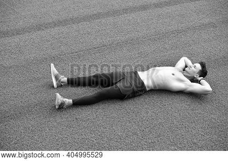 Fit Young Man Resting After From Workout. Relax After Doing Yoga. Mind And Body In Harmony. Fit And